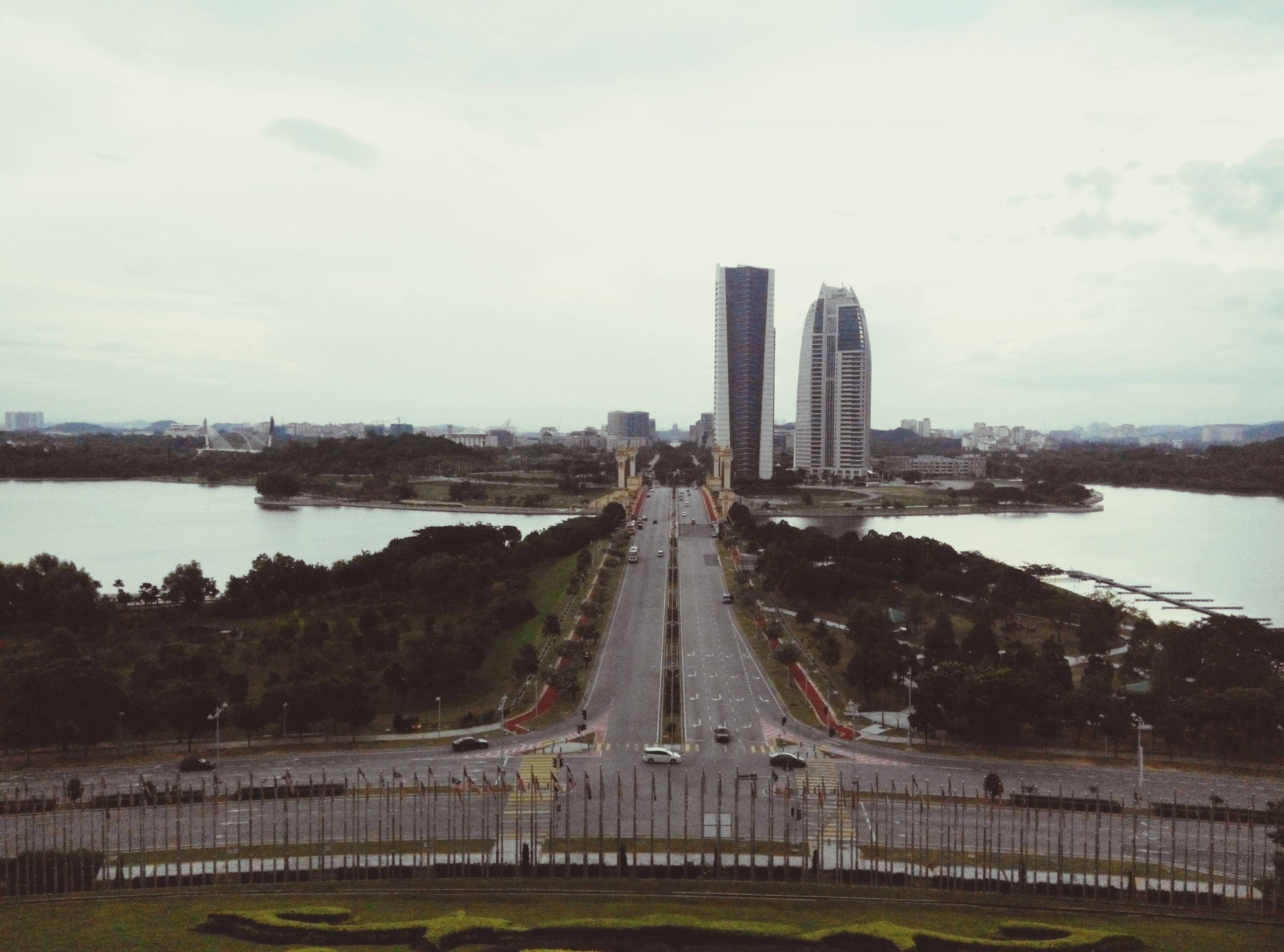 architecture, built structure, sky, building exterior, transportation, river, city, water, bridge - man made structure, connection, cloud - sky, road, tower, travel destinations, tree, famous place, capital cities, the way forward, engineering, travel