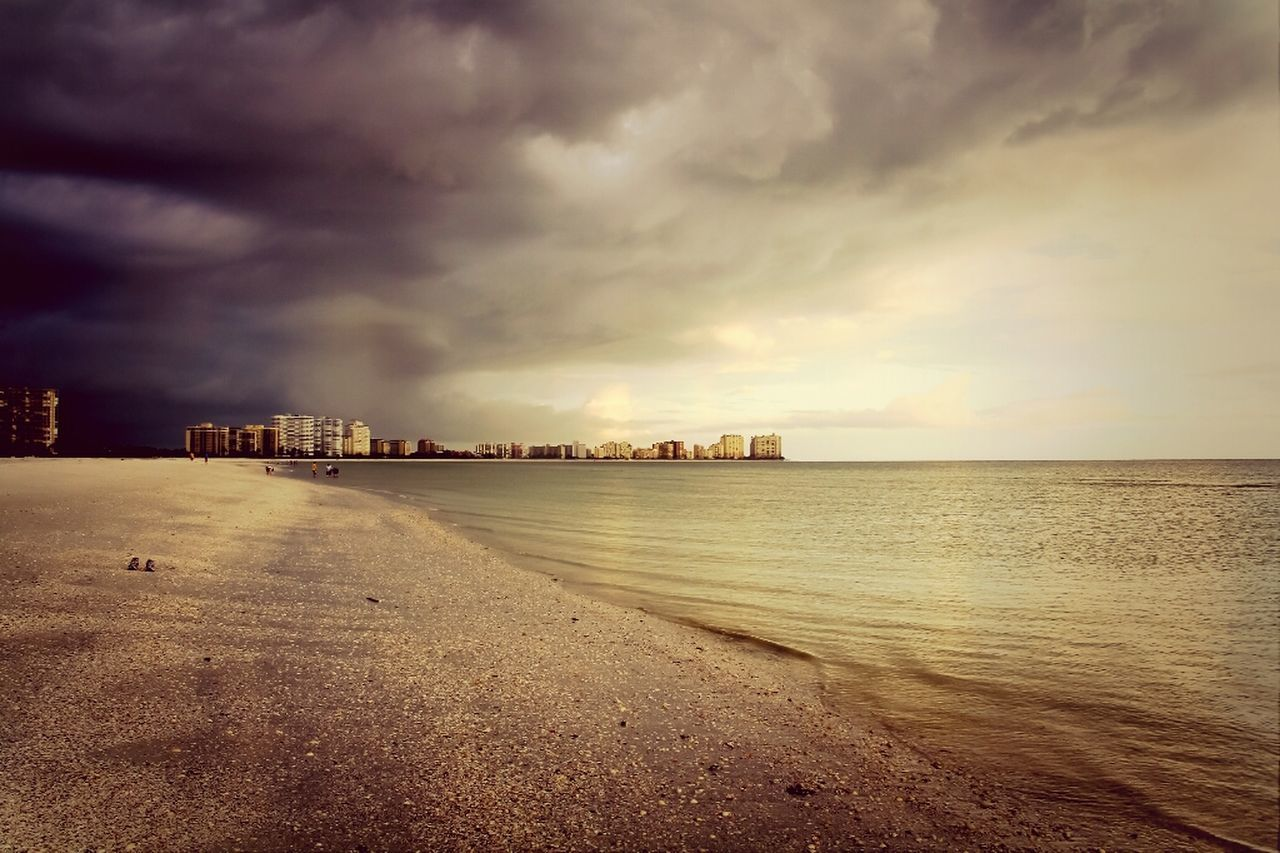 cloud - sky, sky, sea, dramatic sky, sunset, storm cloud, outdoors, nature, no people, built structure, beauty in nature, scenics, horizon over water, water, beach, transportation, tranquility, architecture, building exterior, day, city