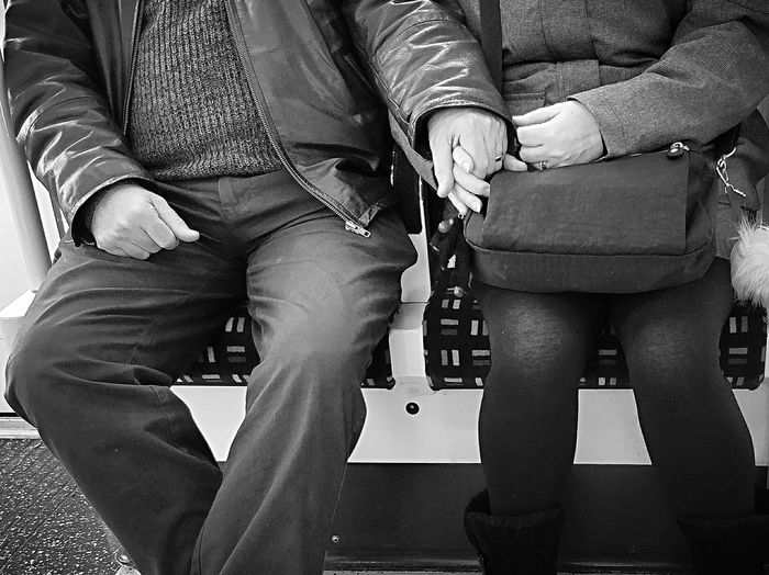 All you need is love ... whatever the age.. Love Public Transport Bw_collection Holding Hands Valentine's Day  Streetphoto_bw Relationship Couple Older  Two People Indoors  Togetherness Low Section Human Body Part Women Real People Adult Day Bonding Adults Only Men Close-up