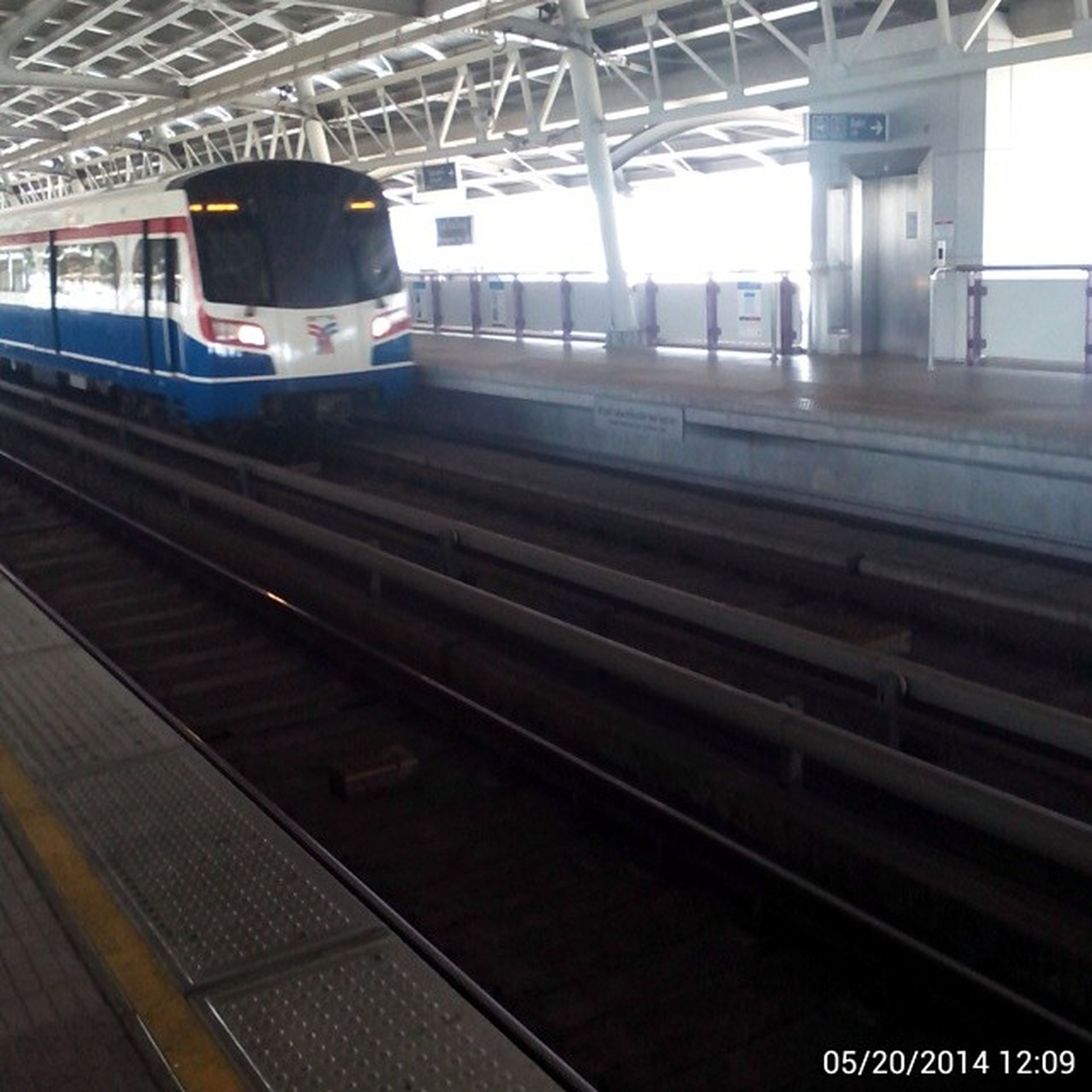 railroad track, rail transportation, public transportation, transportation, railroad station platform, railroad station, train - vehicle, mode of transport, passenger train, travel, train, public transport, indoors, railway station, built structure, journey, railway track, incidental people, architecture, station