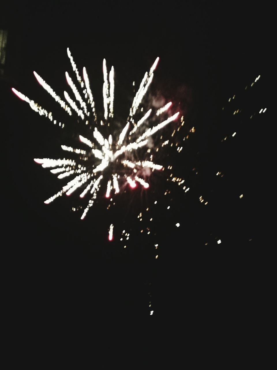 celebration, night, firework display, firework - man made object, exploding, long exposure, arts culture and entertainment, event, illuminated, glowing, low angle view, motion, blurred motion, no people, multi colored, firework, outdoors, sky