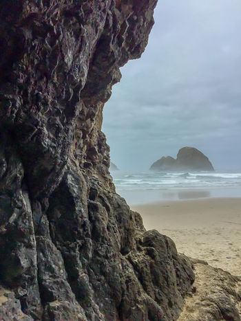 ©Amy Boyle Photography Atmospheric Mood Beach Beauty In Nature Cliff Cloud - Sky Driftwood Eroded Geology Majestic Nature Non-urban Scene Rock - Object Rock Formation Rocky Mountains Rough Scenics Sea Shore Sky Textured  Tranquil Scene Tranquility Tree Tree Trunk Water