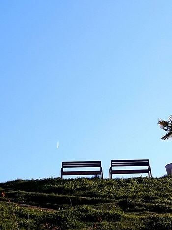 Benches Airplane Nature Outdoors Sky No People Day Grass Tranquility Blue Landscape Beauty In Nature