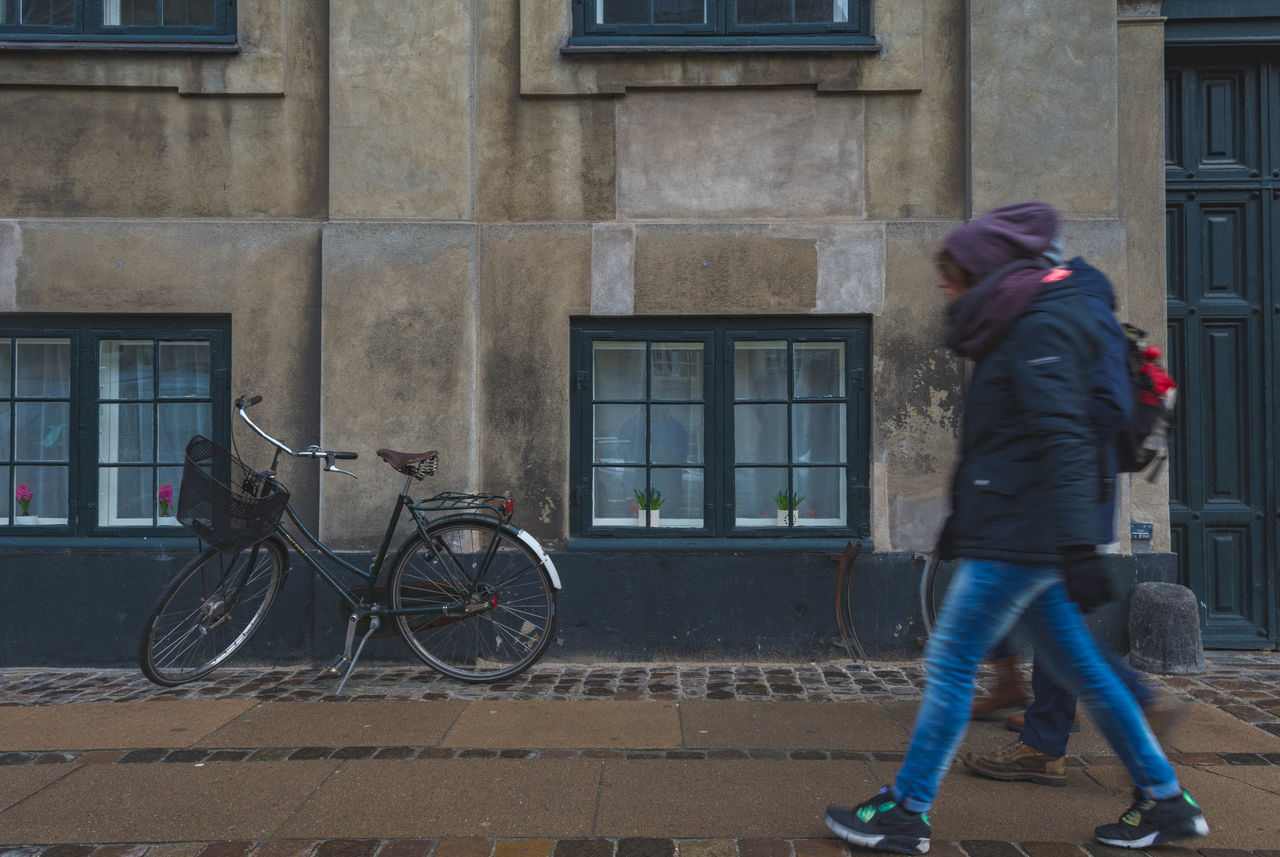 Damp day Architecture Bicycle Building Exterior Built Structure City Copenhagen Danmark Day Denmark Knit Hat Leisure Activity Mode Of Transport One Person People Real People Transportation