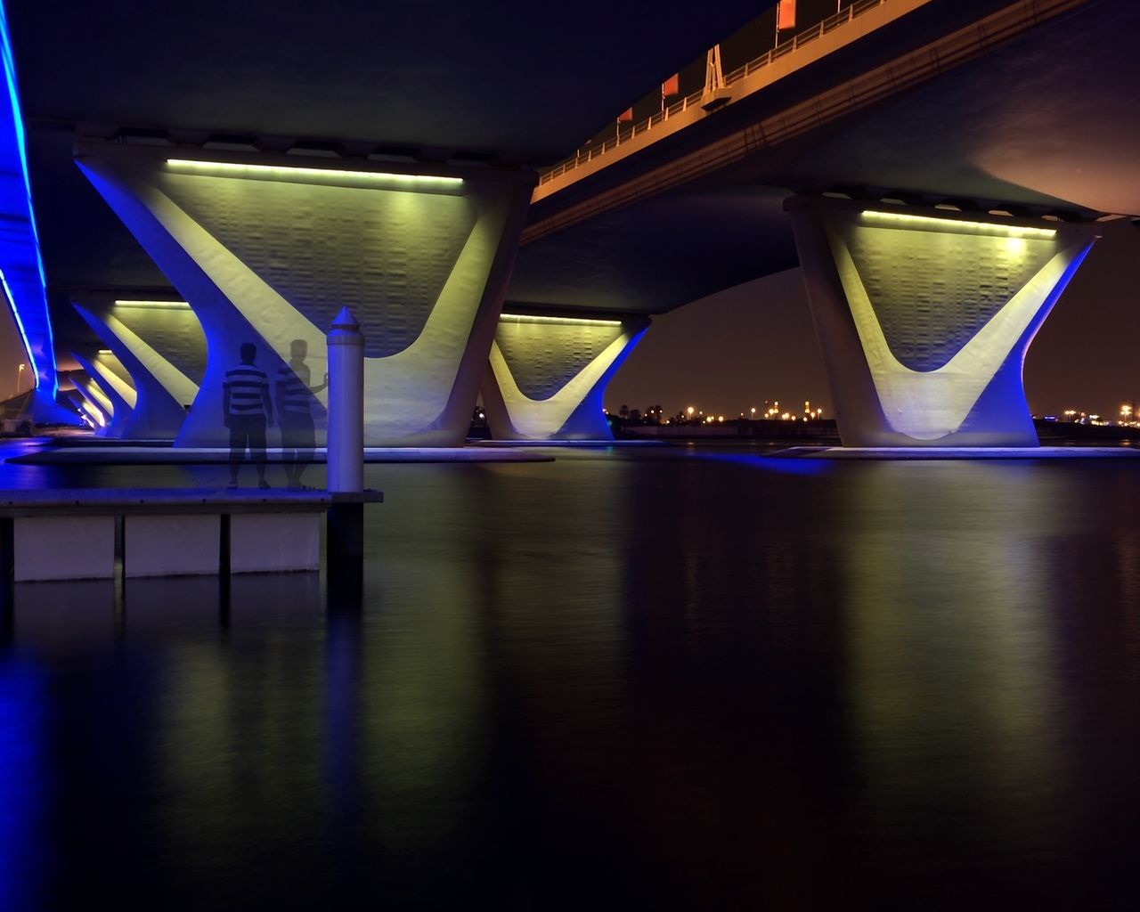 illuminated, bridge - man made structure, architecture, night, lighting equipment, connection, built structure, reflection, transportation, no people, waterfront, water, architectural column, indoors, modern, city