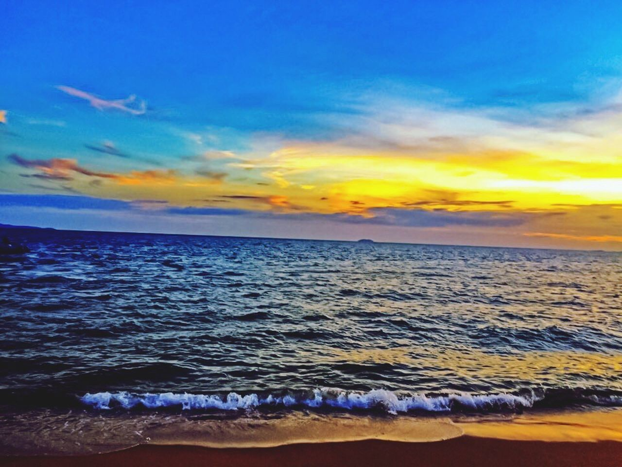 sea, sunset, beauty in nature, scenics, nature, water, horizon over water, sky, beach, tranquil scene, wave, tranquility, idyllic, no people, cloud - sky, outdoors, sand, vacations, day