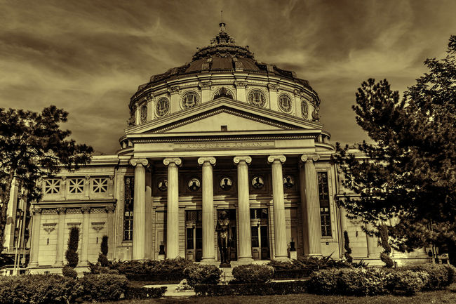Image with Romanian Athenaeum Athenaeum Architecture Bucharest Building Exterior Built Structure City City Gate Cloud - Sky Day Dome Government Government Building Low Angle View No People Outdoors Romania Romanian Athenaeum Sky Travel Travel Destinations Tree