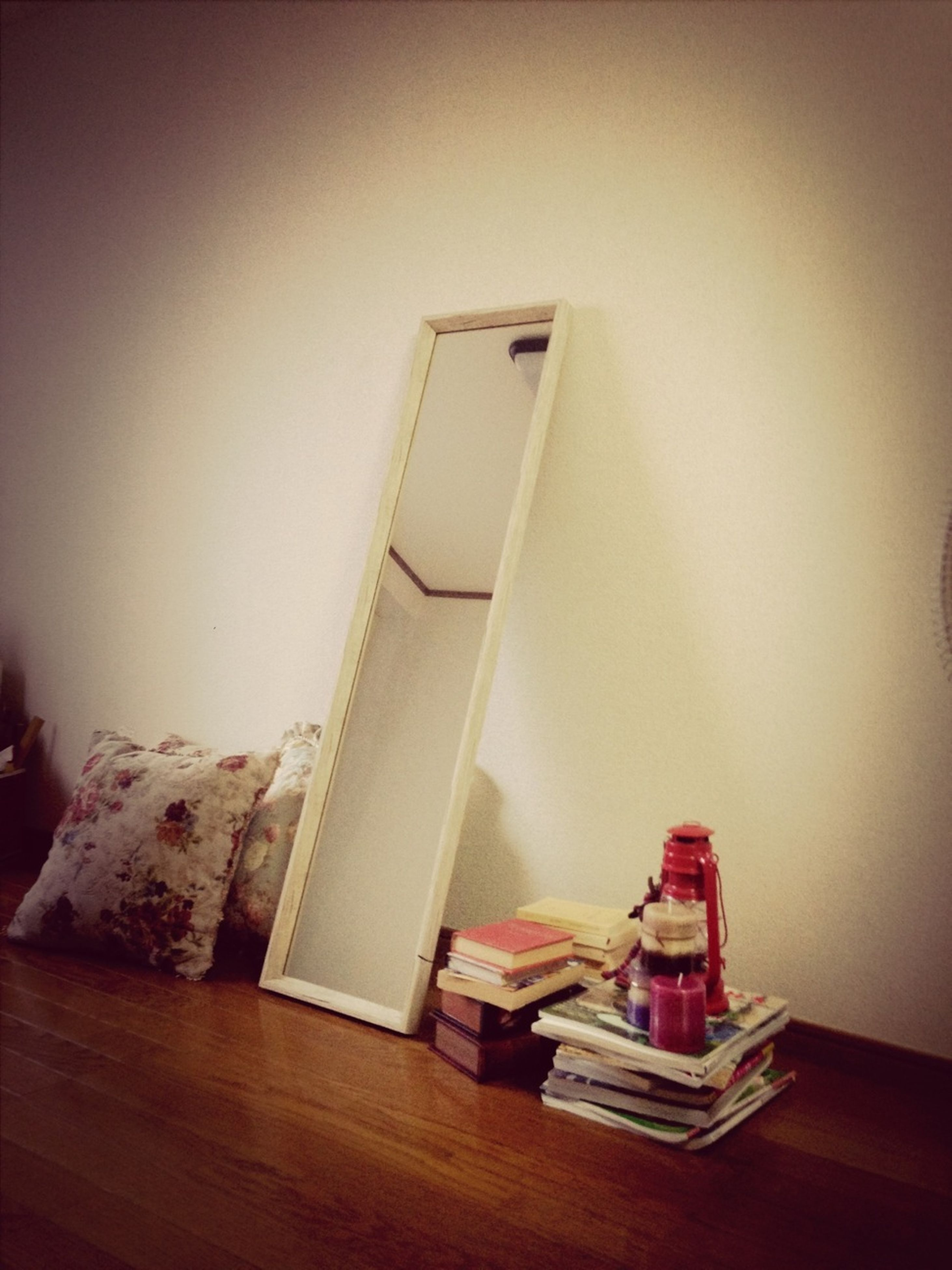 indoors, home interior, still life, table, wall - building feature, house, architecture, no people, built structure, domestic room, chair, copy space, paper, wall, book, absence, hanging, white color, low angle view, wood - material