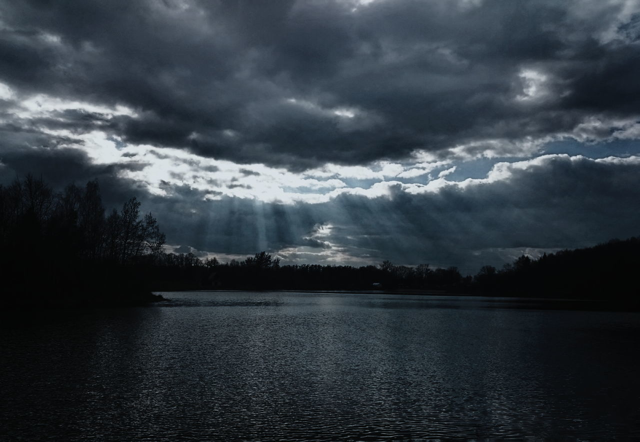 cloud - sky, beauty in nature, nature, tranquility, scenics, tranquil scene, sky, weather, water, no people, lake, outdoors, tree, storm cloud, silhouette, day, landscape