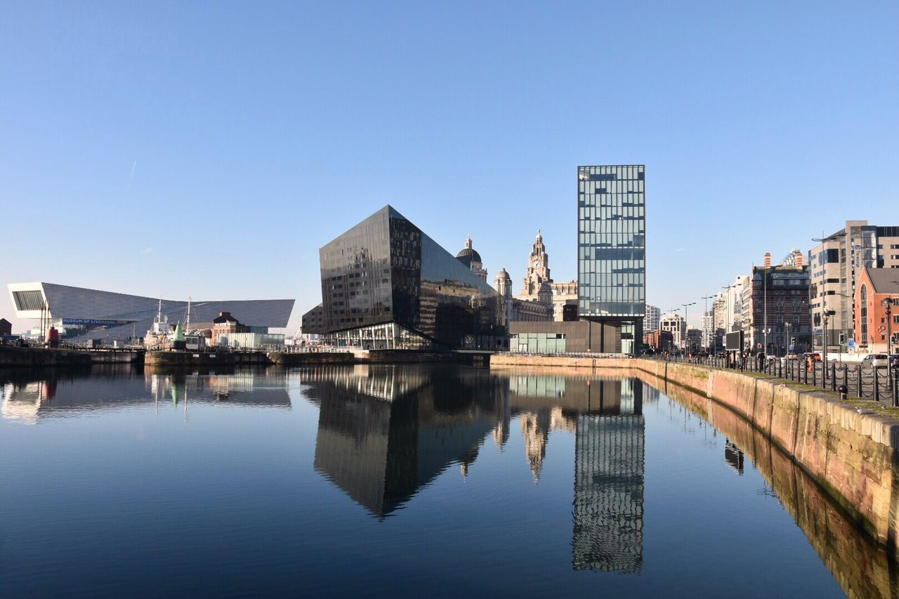 Urban landscape. My Year My View Architecture Built Structure Reflection Building Exterior Water Clear Sky City Waterfront Outdoors Modern Skyscraper No People Day Cityscape Urban Skyline Nature Sky Building Reflections EyeEm Masterclass Reflections In The Water EyeEm Gallery City Landscape Modern Architecture in Liverpool