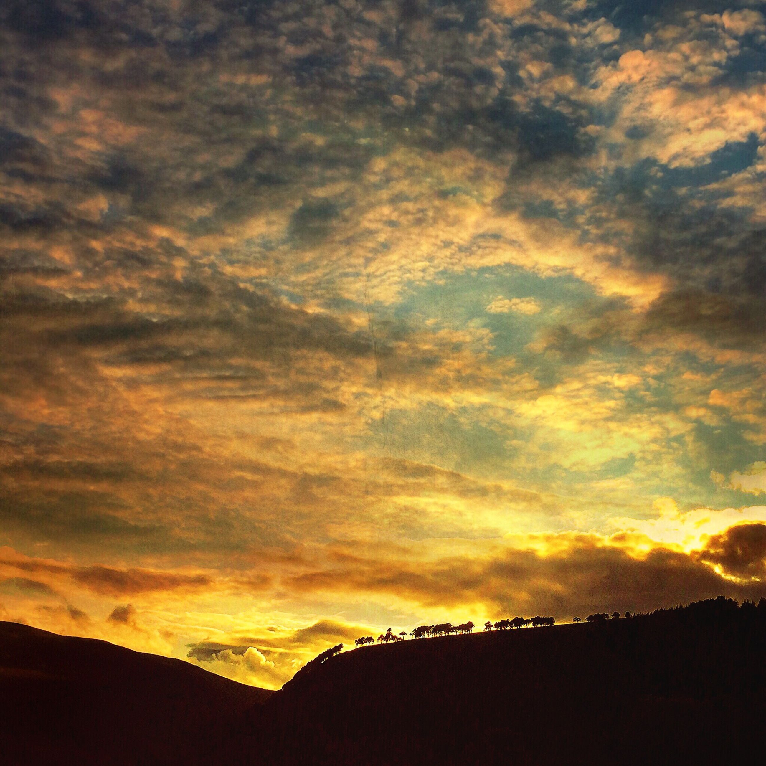 sunset, sky, cloud - sky, silhouette, low angle view, cloudy, orange color, scenics, beauty in nature, built structure, architecture, dramatic sky, cloud, tranquility, tranquil scene, nature, building exterior, idyllic, weather, outdoors