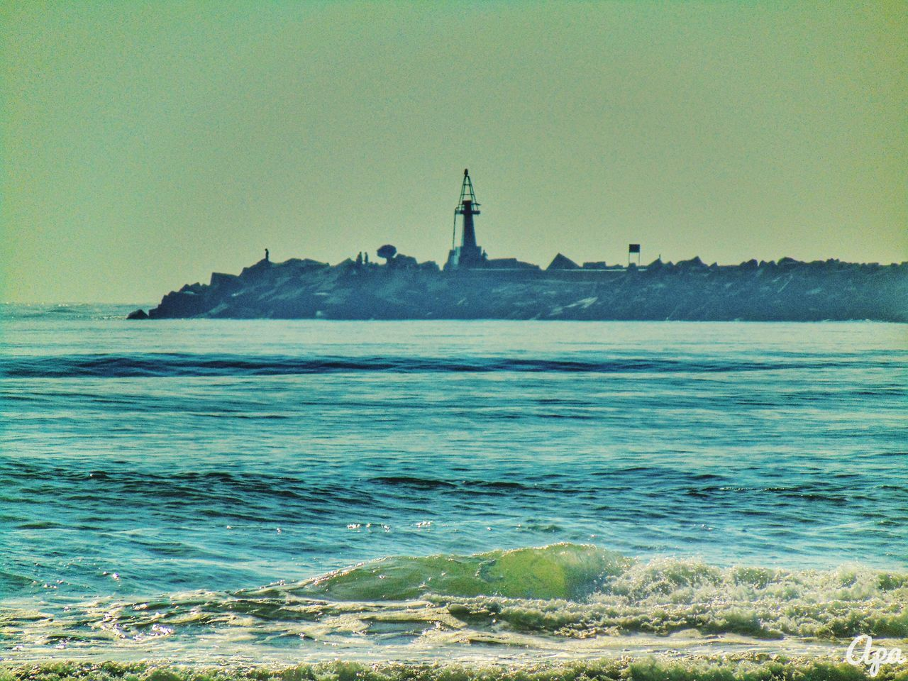 sea, lighthouse, water, nature, travel destinations, tranquility, outdoors, sky, horizon over water, scenics, no people, beauty in nature, clear sky, day, beach, statue, architecture, wave