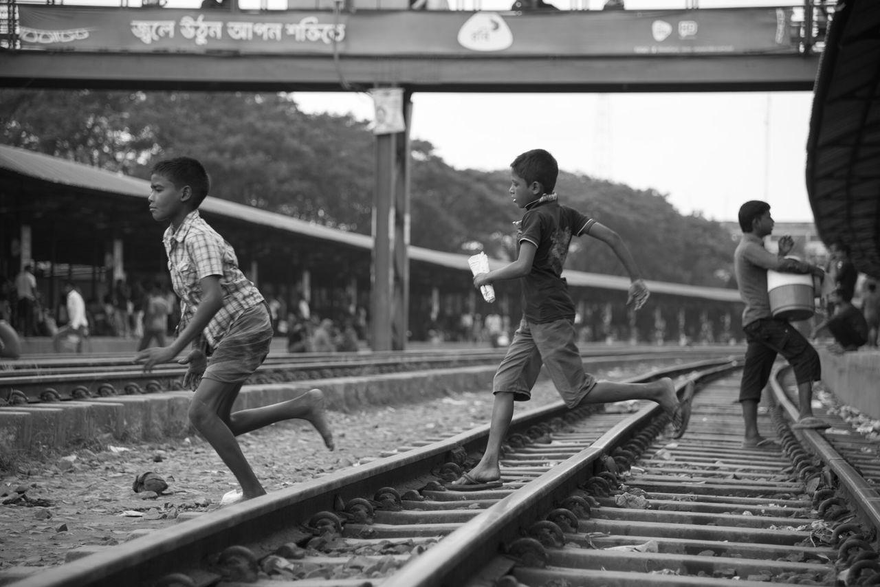 railroad track, rail transportation, transportation, public transportation, train - vehicle, full length, real people, day, men, outdoors, adult, people