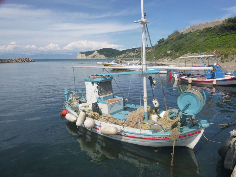 Beauty In Nature Blue Calm Cloud Cloud - Sky Day Fishing Boat Idyllic Mast Mode Of Transport Mountain Nature Nautical Vessel No People Non-urban Scene Outdoors Rippled Sailboat San Stefanos, Corfu, Greece Scenics Sky Tranquil Scene Tranquility Transportation Water