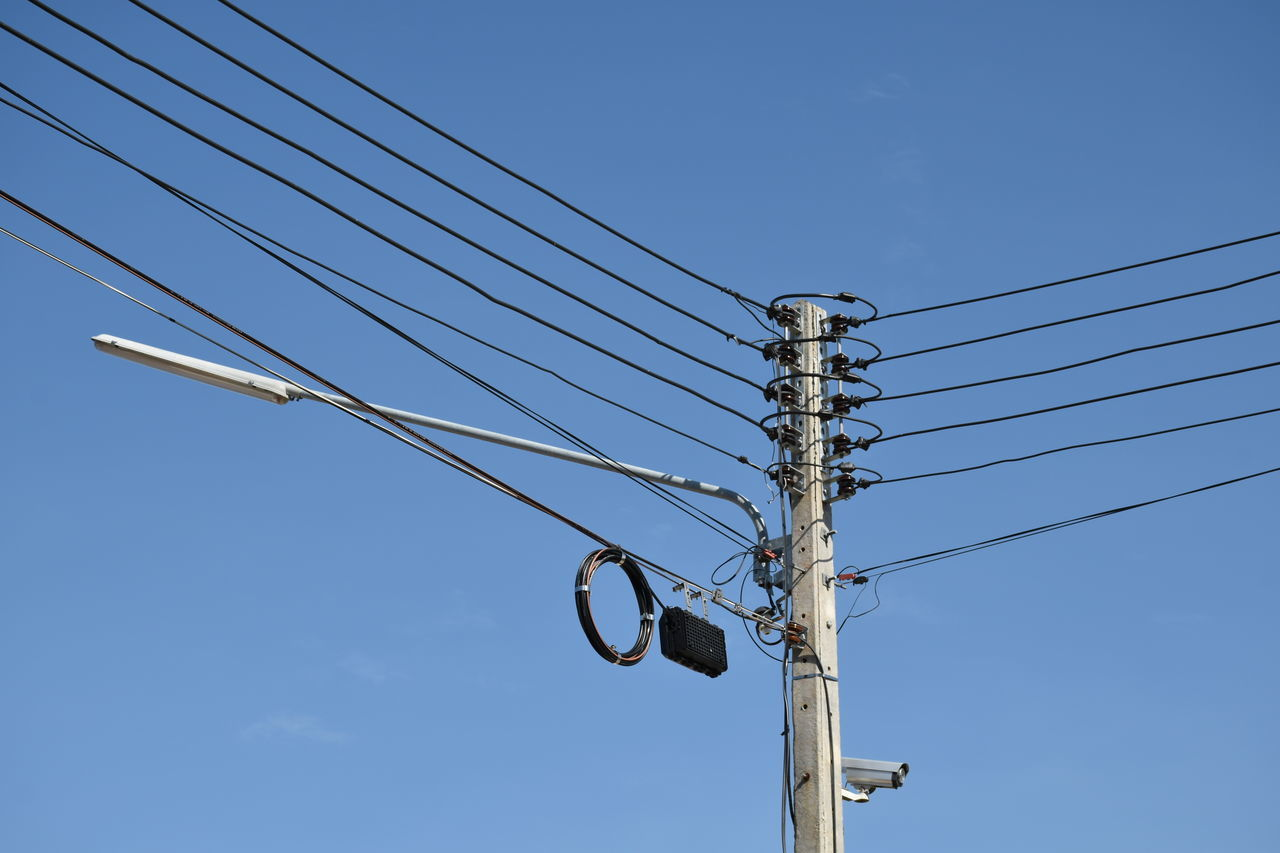 . . . ร ก . . . Blue Cable Clear Sky Connection Day Electricity  Electricity Pylon Fuel And Power Generation Low Angle View No People Outdoors Power Line  Power Supply Sky Technology
