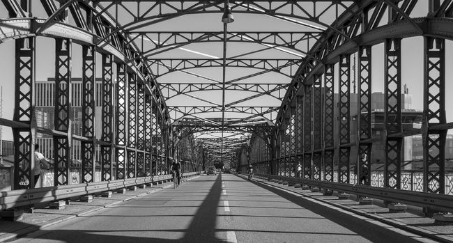 Architecture B&w Black And White Bridge Bridge - Man Made Structure Brücke Built Structure Connection Diminishing Perspective Engineering Famous Place Hackerbrücke Incidental People Iron - Metal Light And Shadow Surface Level The Way Forward Travel Destinations Urban Skyline Vanishing Point