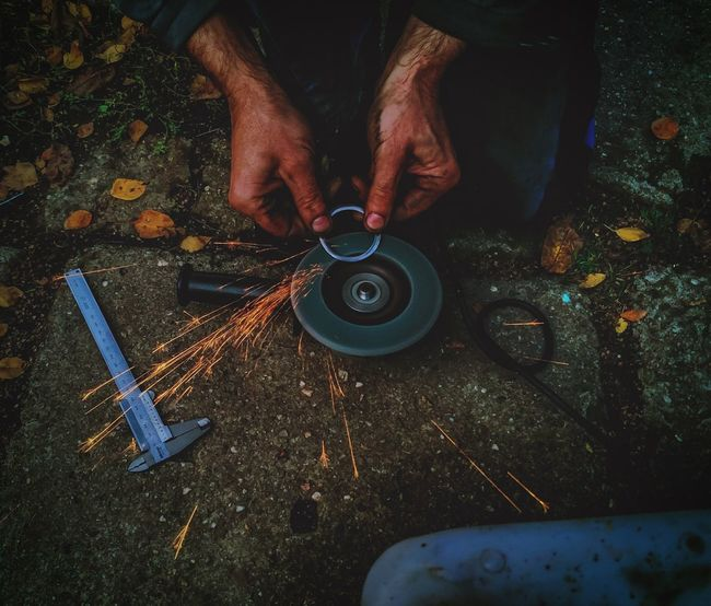 Low Section Part Of Person Holding Outdoors Working Grinding Oneplus2 Mobilephoto Mobilephotography Mobile_photographer Oneplus2photography Hard Sparkle Iron Engineer