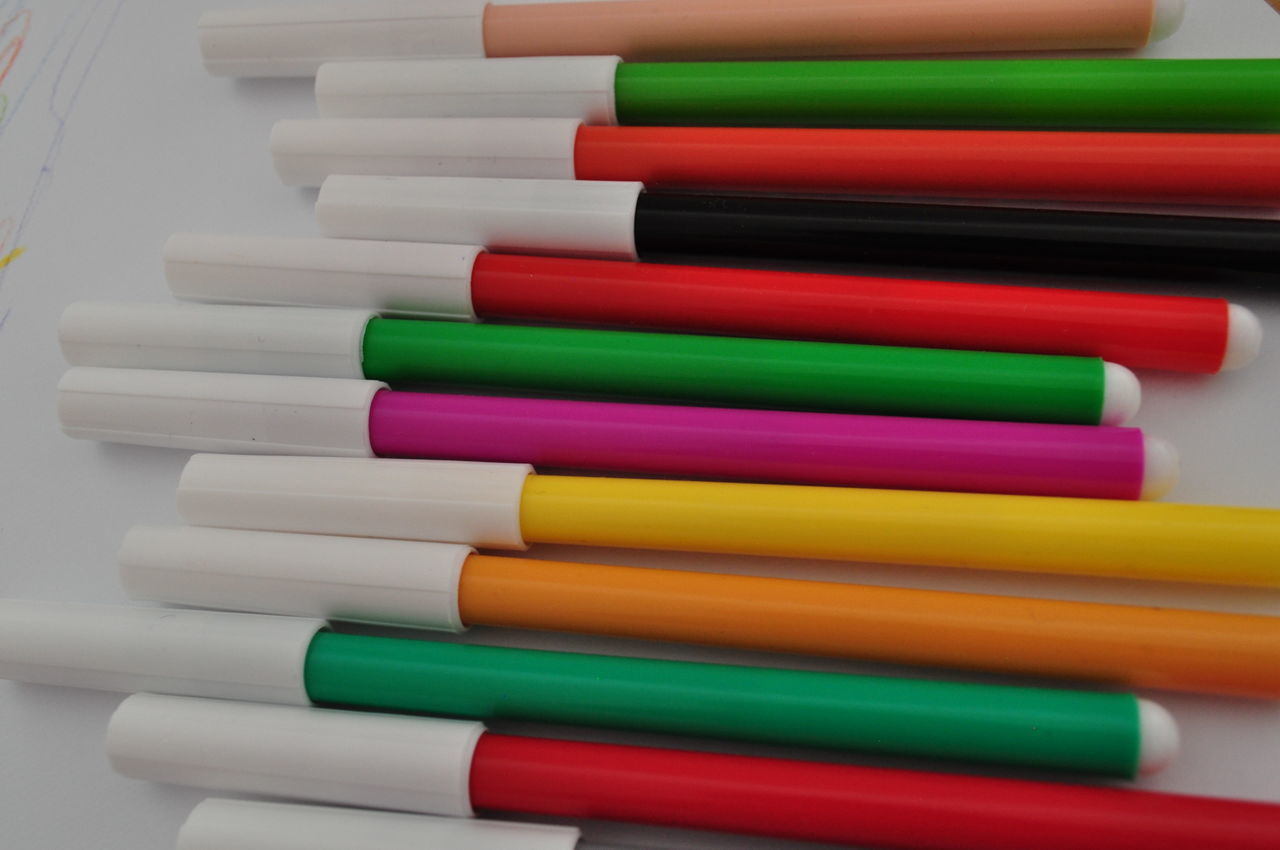 Colored Pencils And Markers Close-up Color Colored Pencils Coloring Pencils Desk Drawing Fun Indoors  Kids Large Group Of Objects Learning Markers  Multi Colored No People Notes Paper Pencils Picture School School Supplies Sketch Still Life Students Table Variation
