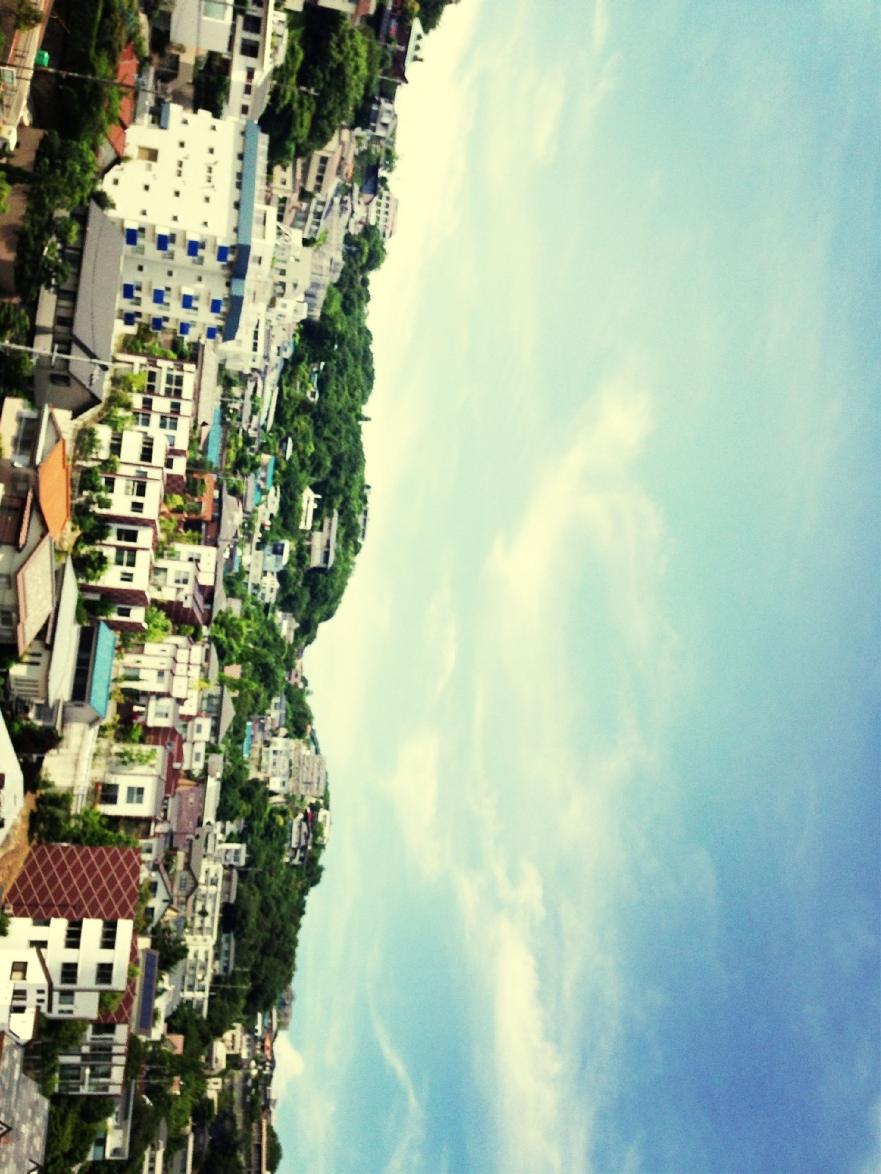 building exterior, architecture, built structure, city, sky, cloud - sky, cityscape, residential building, residential district, residential structure, crowded, cloud, high angle view, cloudy, city life, house, day, tree, town, outdoors