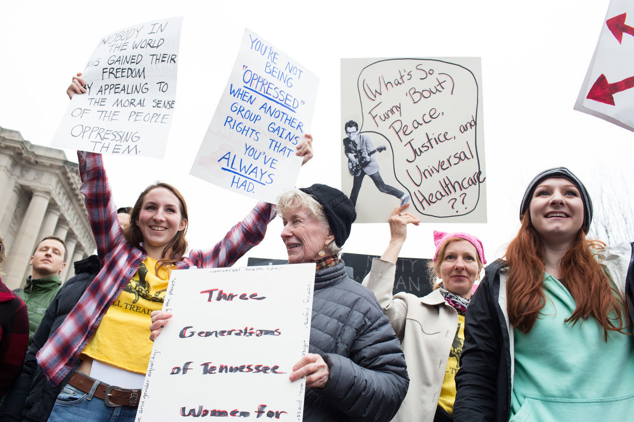 text, protest, communication, protestor, placard, politics, real people, casual clothing, message, day, holding, women, men, outdoors, young adult, people
