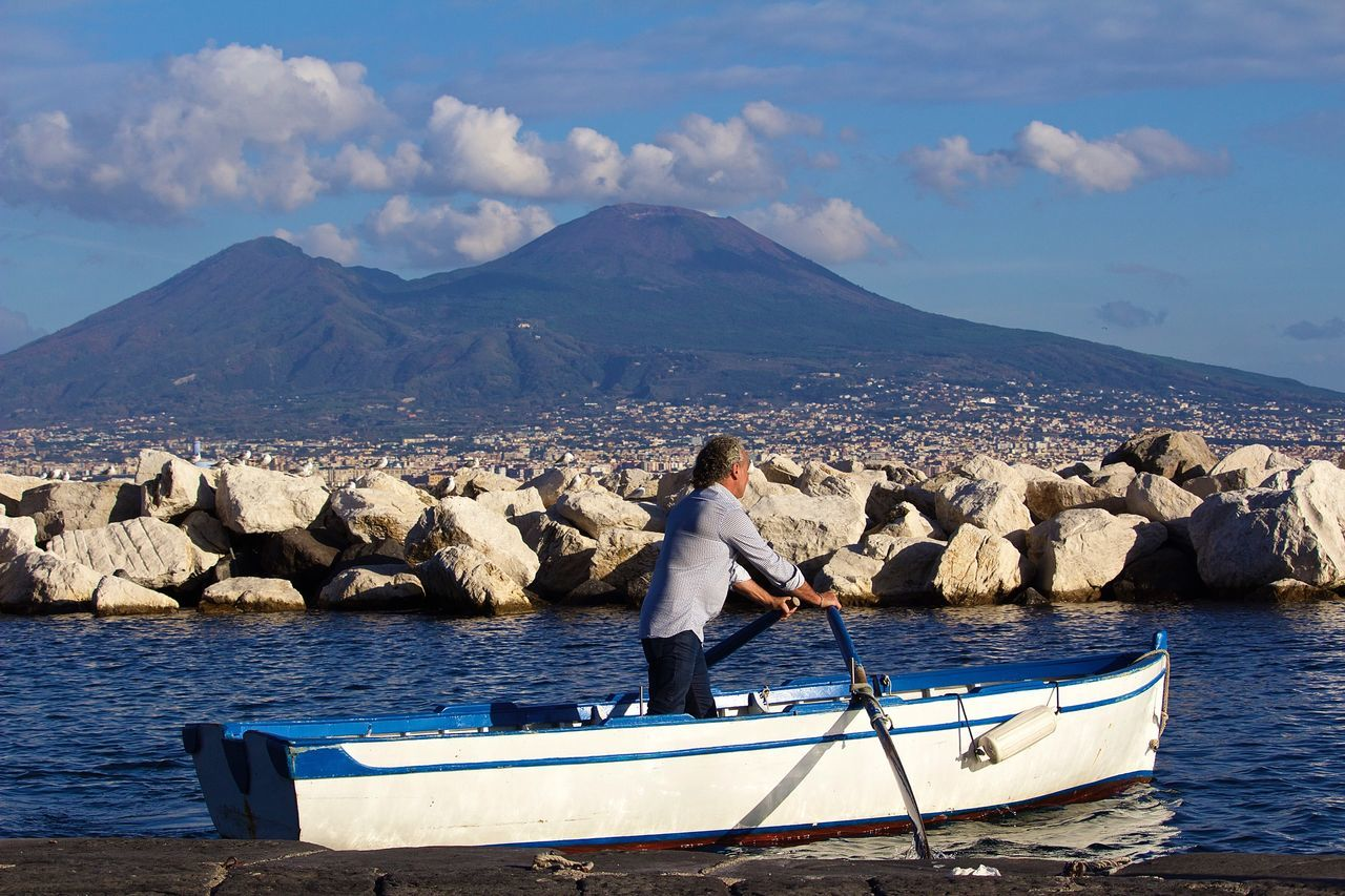 Napoli Napoliphotoproject Napoli Italy Naples Vesuvio Sky Real People Mountain One Person Beauty In Nature Day Cloud - Sky Water Sea Full Length Scenics Outdoors Nature Men Mountain Range Leisure Activity Standing Adapted To The City