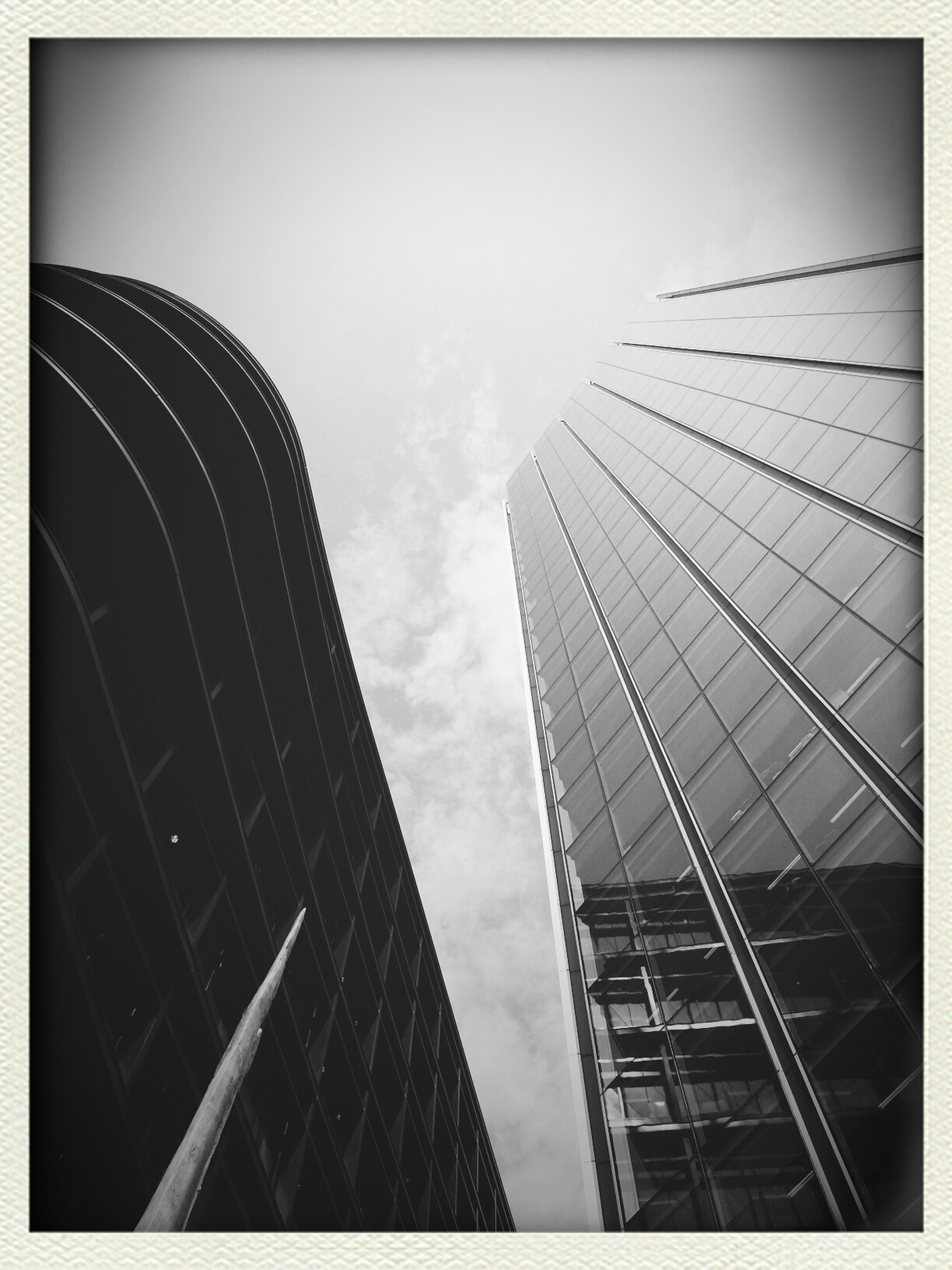 transfer print, architecture, auto post production filter, building exterior, built structure, low angle view, modern, skyscraper, tower, city, office building, tall - high, sky, glass - material, building, capital cities, reflection, day, outdoors, tall