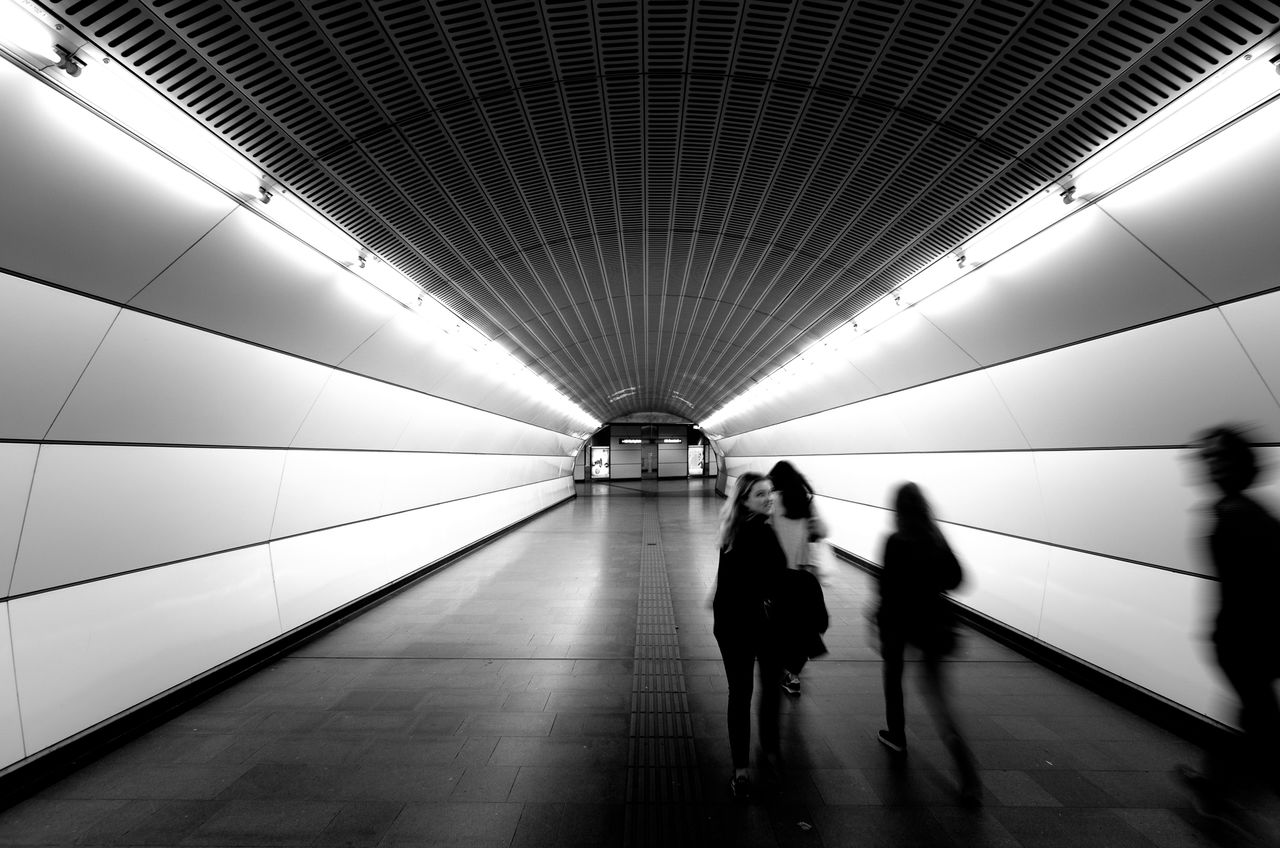 Through the tunnel \ Tunnel Vanishing Point People Rush Traveling Transportation Urban Symmetry Blackandwhite Monochrome Fortheloveofblackandwhite Light And Shadow Modern Architecture Architecture Darkness And Light Notes From The Underground Underground light and reflection Light In The Darkness Silhouette My Year My View Underground Station  Vienna in Wien, Austria