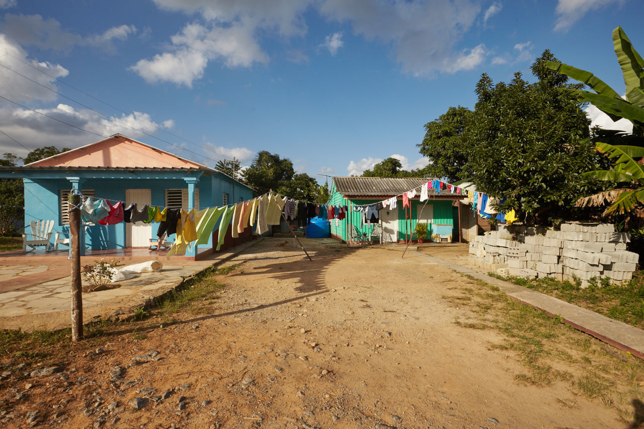 Architecture Building Exterior Built Structure Clothes Line Cloud - Sky Countryside Cuban Life Day Laundry Day Nature No People Outdoors Sand Sky Tobacco Leaf Tree