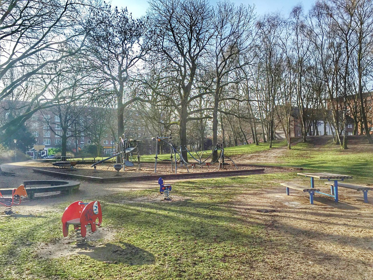 bare tree, tree, playground, real people, childhood, park - man made space, playing, outdoors, girls, lifestyles, day, togetherness, growth, child, nature, men, grass, people, sky, adult