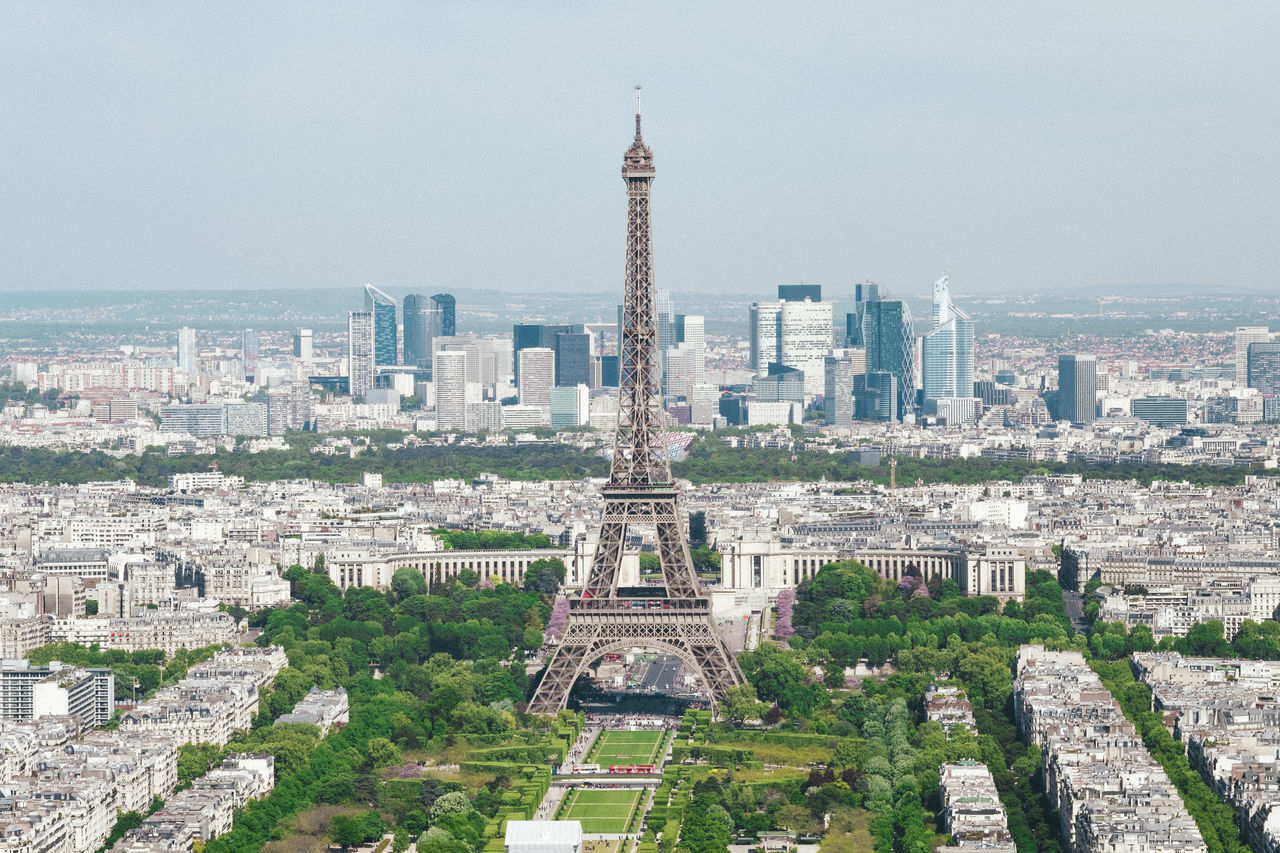 Aerial View Architecture Building Exterior Built Structure Centered Champs De Mars City Cityscape Copy Space Day Eiffel Tower Famous Place Green Color History Houses No People On Top Of Outdoors Panoramic Public Park Sky Tall - High Tourism Travel Travel Destinations