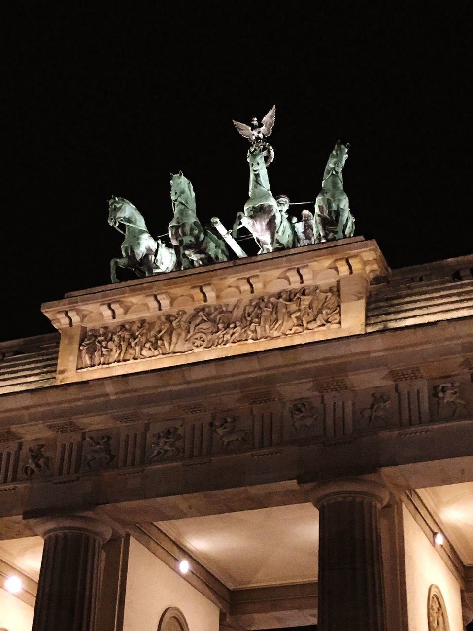 statue, sculpture, low angle view, architecture, travel destinations, art and craft, history, tourism, built structure, human representation, carving - craft product, outdoors, night, monument, triumphal arch, travel, architectural column, no people, sky, city gate, illuminated, building exterior