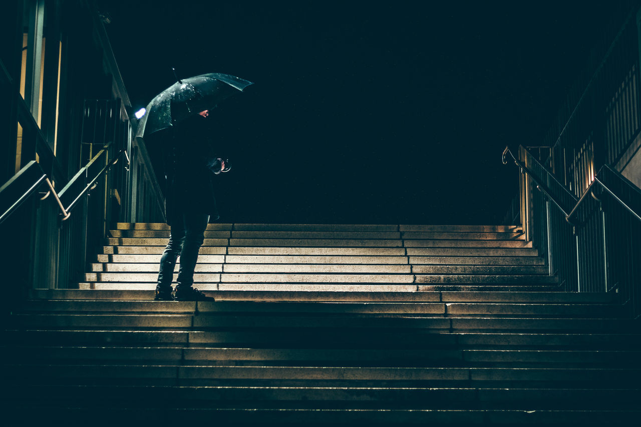 steps, staircase, steps and staircases, railing, one person, full length, night, stairs, men, real people, leisure activity, standing, hand rail, outdoors, illuminated, people