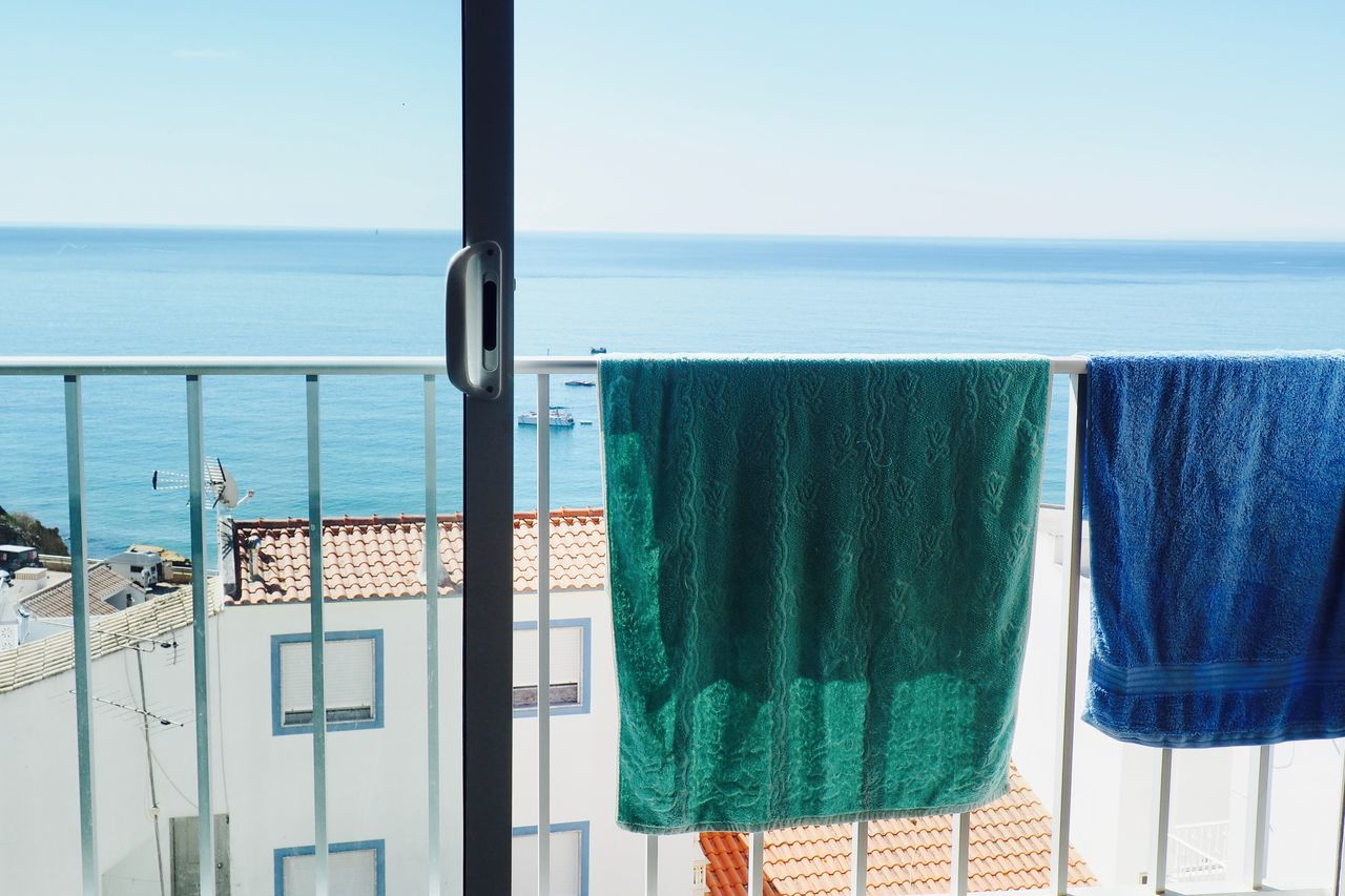 Balcony Beach Beach Life Beachphotography Beauty In Nature Blue Clear Sky Day Hanging Horizon Over Water Laundry Nature No People Outdoors Scenics Sea Sky Sunlight Swimming Towel Tranquil Scene Tranquility Vacations Water