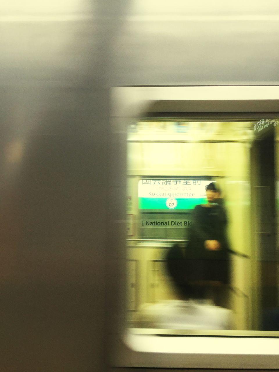 transportation, blurred motion, real people, public transportation, train - vehicle, mode of transport, speed, motion, passenger train, men, passenger, rail transportation, indoors, railroad station, journey, illuminated, one person, subway train, women, lifestyles, day, people