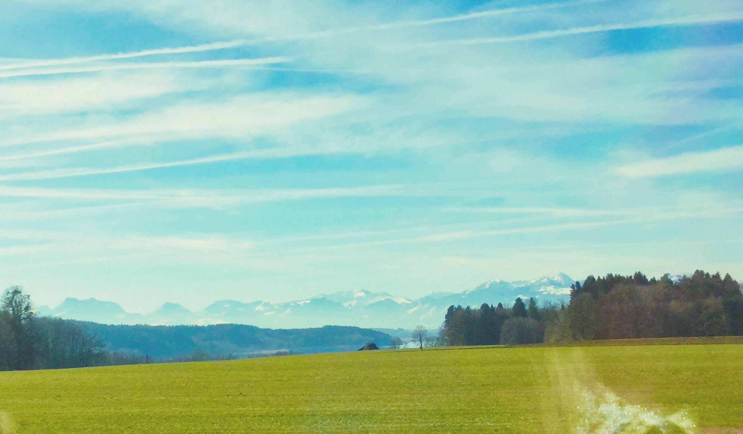 tranquil scene, tranquility, landscape, scenics, beauty in nature, mountain, sky, nature, field, idyllic, mountain range, tree, non-urban scene, green color, grass, cloud - sky, cloud, rural scene, remote, no people