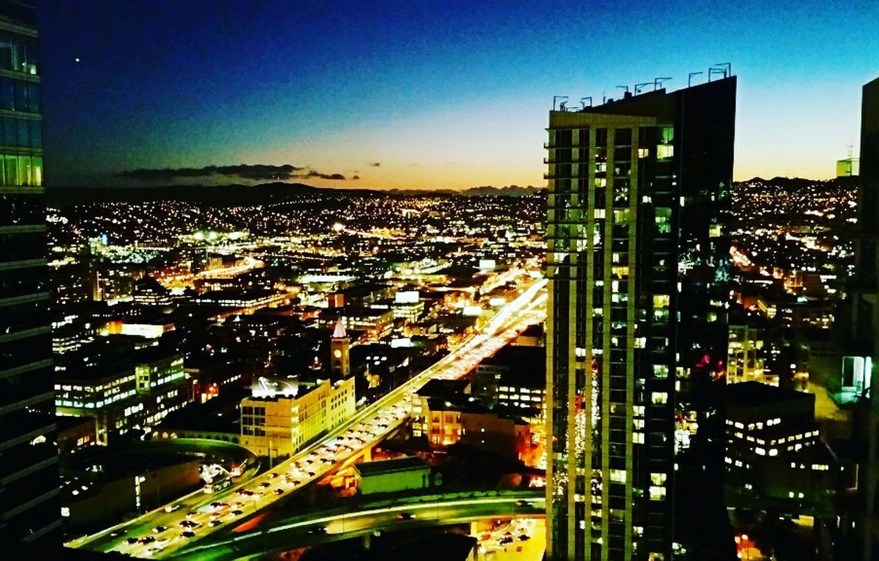 architecture, cityscape, city, building exterior, illuminated, built structure, city life, night, skyscraper, outdoors, no people, travel destinations, road, sky, modern