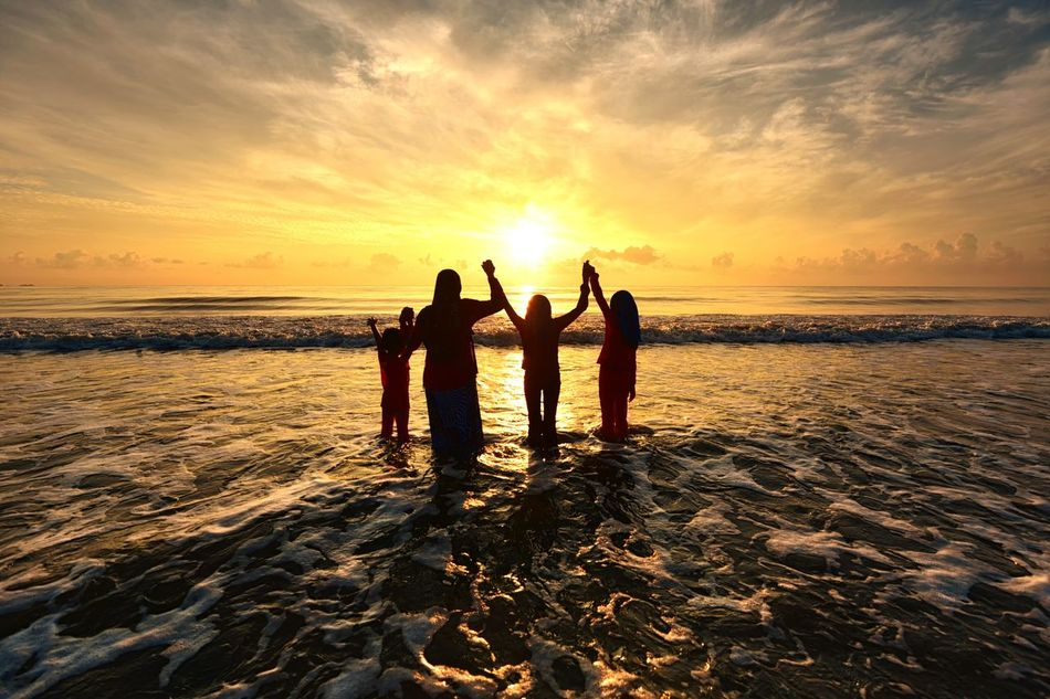 Happy family on the beach Sunset Sunrise Family People Mother Daughter Beach Sea Vacations Silhouette Togetherness Water Sky Enjoyment Concept EyeEm Best Shots Getty Images EyeEmBestPics EyeEm Gallery Background Landscape Travel Holiday Travel Destinations Sun