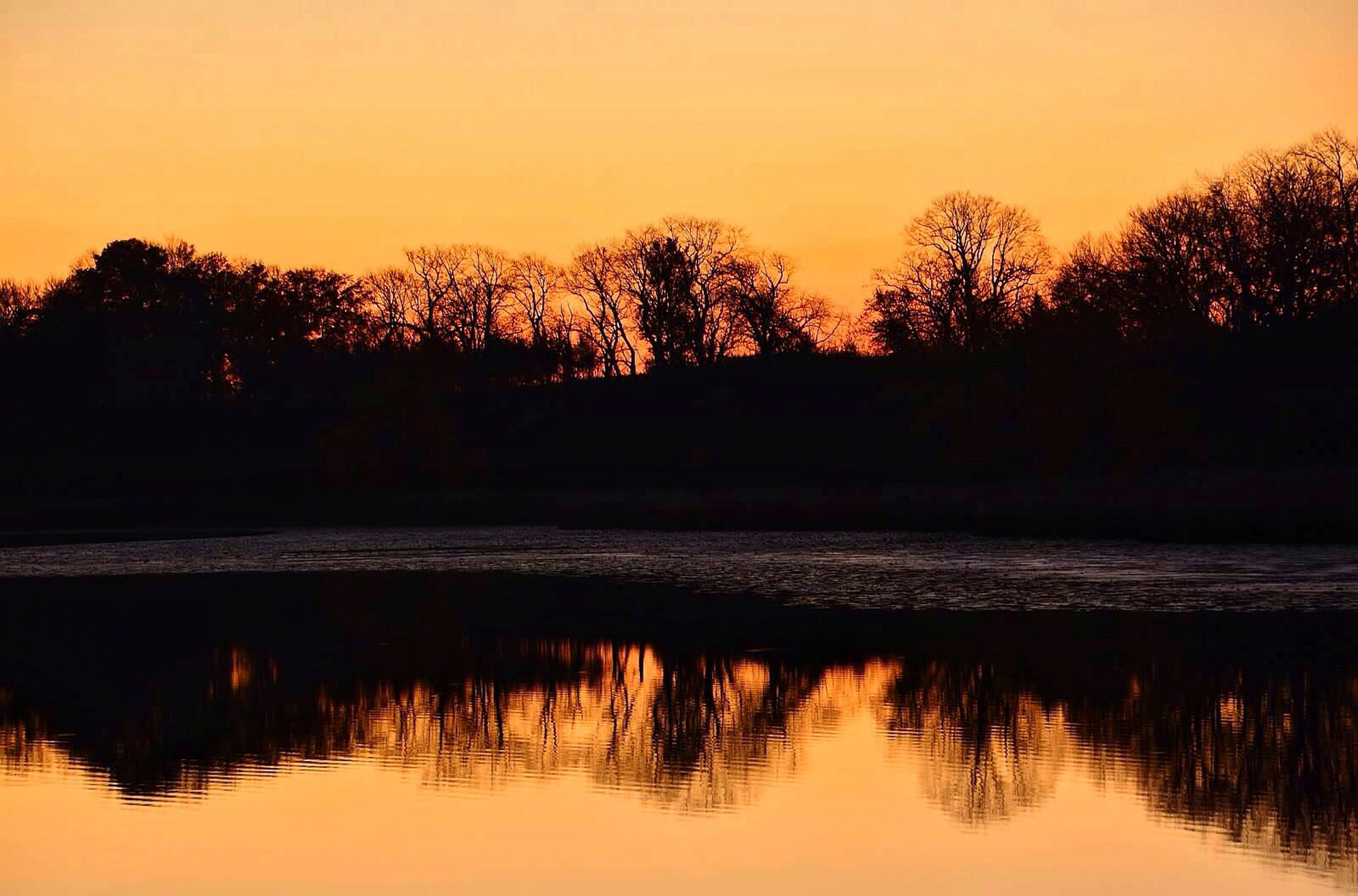 sunset, water, silhouette, tree, tranquil scene, tranquility, scenics, beauty in nature, sky, nature, waterfront, reflection, lake, orange color, idyllic, rippled, sea, sun, outdoors, no people