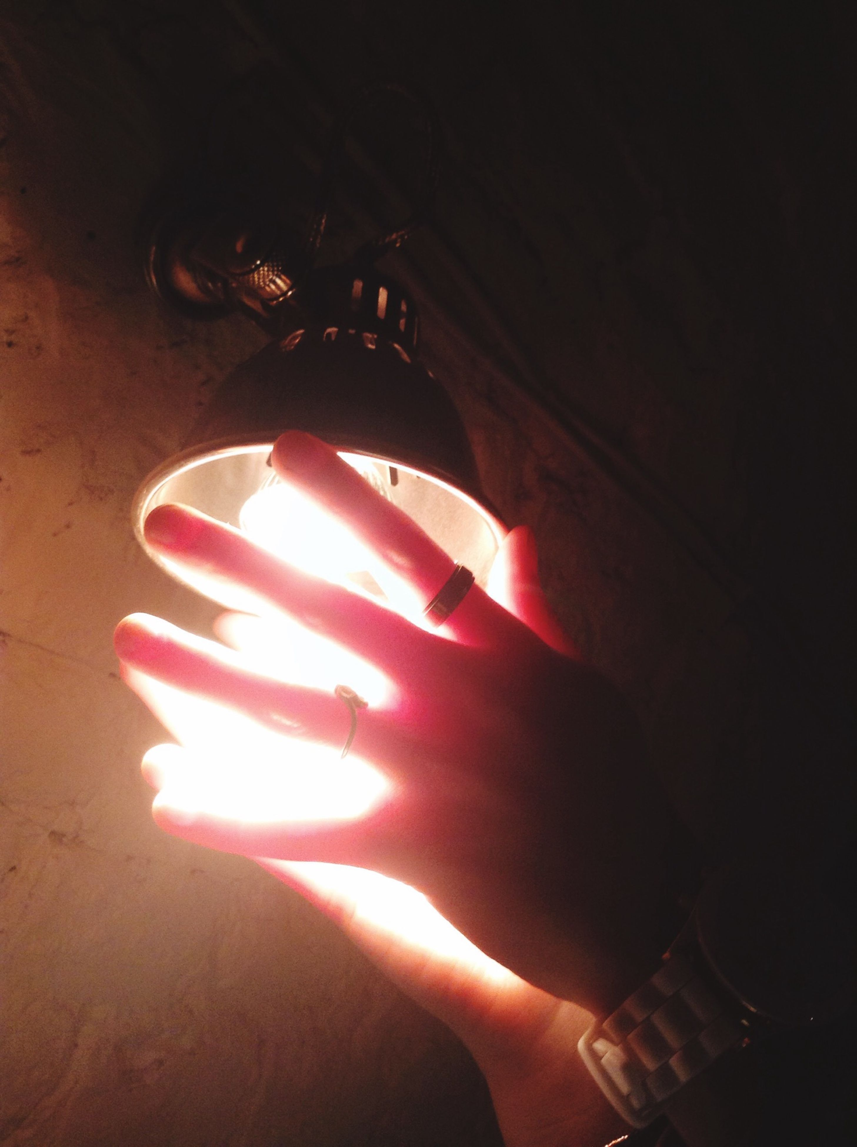 person, part of, holding, personal perspective, lifestyles, cropped, human finger, unrecognizable person, leisure activity, indoors, burning, sunlight, men, close-up, flame, wall - building feature, illuminated