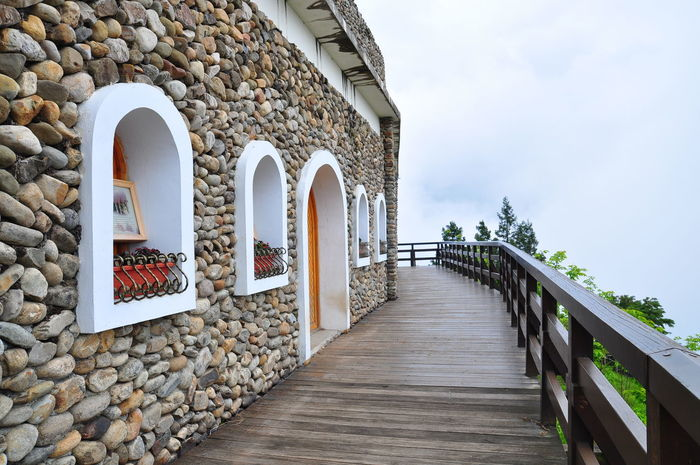 Built Structure Cingjing Cingjing Farm Countryside Doors And Windows Around The World Peace And Quiet Railing Rustic Stone Cottage Taichung Taiwan Walkway Wooden Walkway