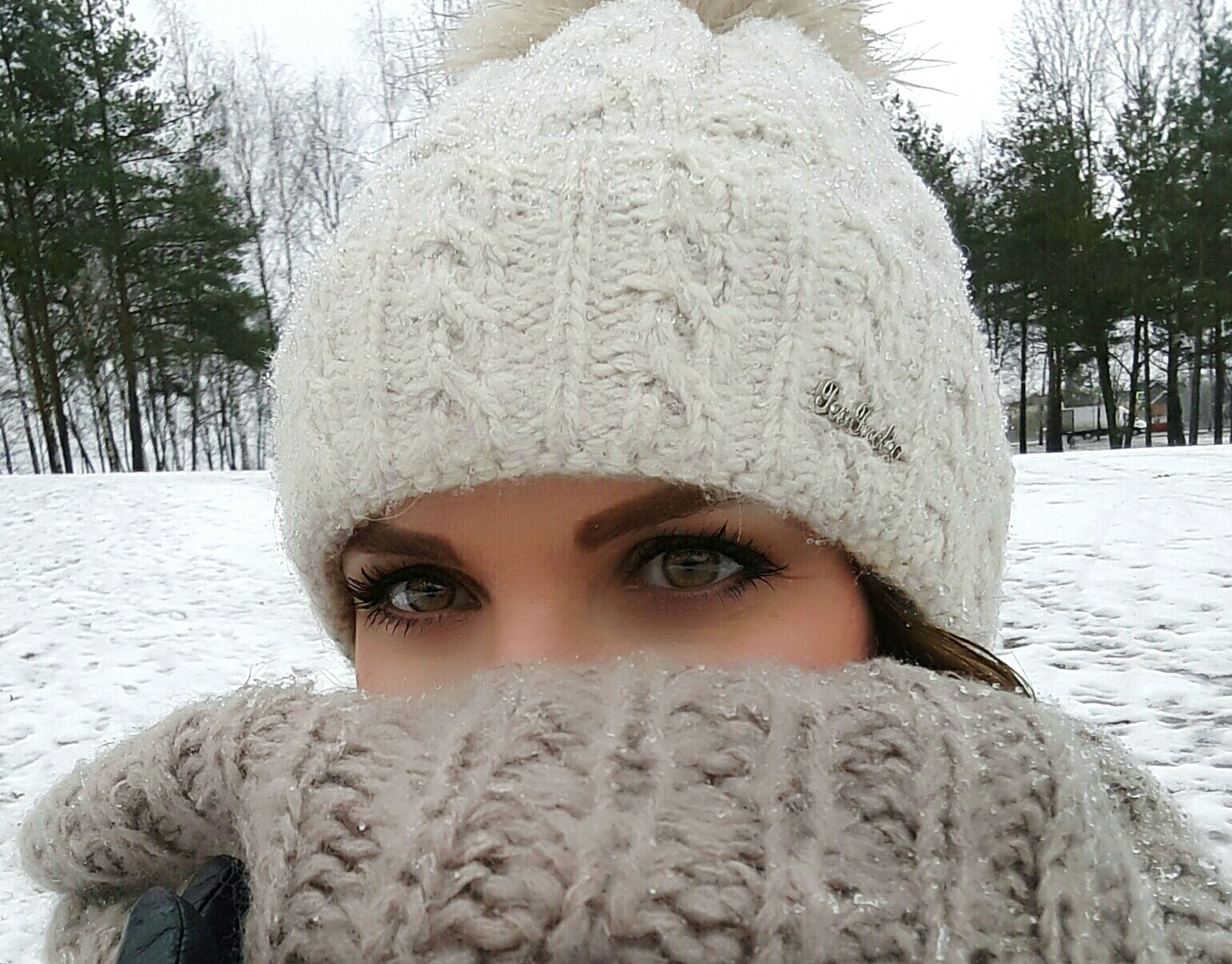 snow, cold temperature, winter, looking at camera, portrait, young adult, one person, headshot, young women, human face, warm clothing, one young woman only, close-up, outdoors, tree, only women, real people, adults only, people, one woman only, day, adult, nature, human body part
