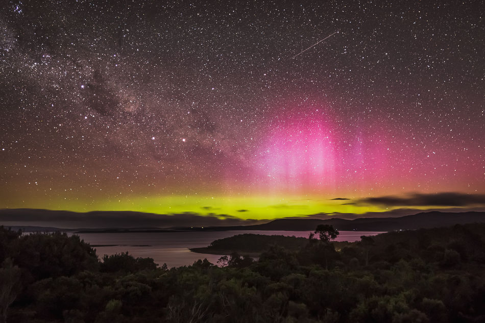The Aurora Australis or Southern Lights light up the night sky looking down onto the Great Lake of Tasmania's Central Plateau which resides at an elevation of 1,036 m (3,398 feet). Green aurora tend to occur at altitudes from 100 – 250 km by oxygen atoms emitting light at 557.7 nano-metres. Red aurora are less common and form around 200 – 500 km from oxygen atoms emitting light at 630 nm. Tasmania, Australia Love Life, Love Photography Astronomy Aurora Australia Australis Beautiful Beauty In Nature Clouds Green Lake Light Lights Long Exposure Nature Night Pink Red Scenics Sky Southern Star - Space Stars Tasmania Tranquil Scene Tranquility Yellow