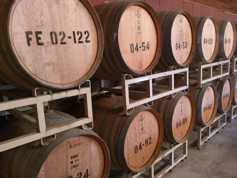 Alcohol Barrel Basement Cellar Close-up Day Drink Food And Drink Industry In A Row Indoors  Keg No People Stack Text Warehouse Wine Wine Cask Wine Cellar Winemaking Winery Winetasting Wood - Material