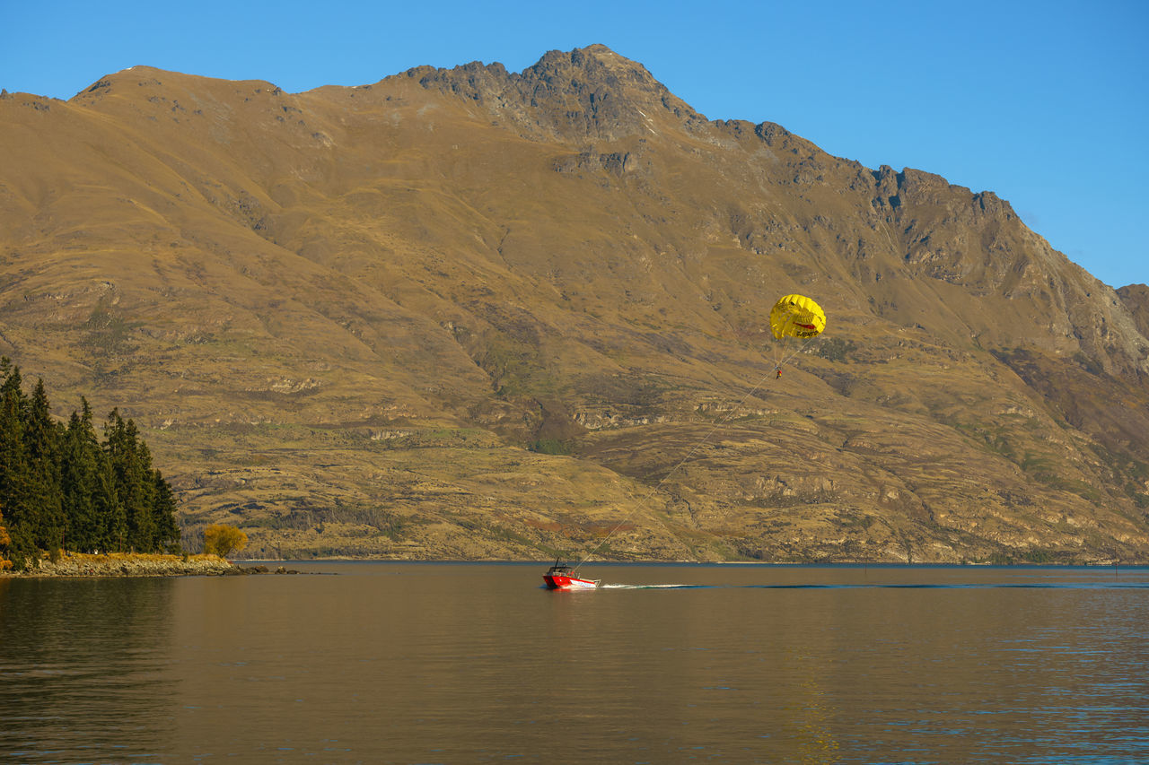 Parasailing at Queenstown, NZ Beauty In Nature Day Lake Landscape Mountain Nature Nautical Vessel Outdoors Pedal Boat People Scenics Sky Water