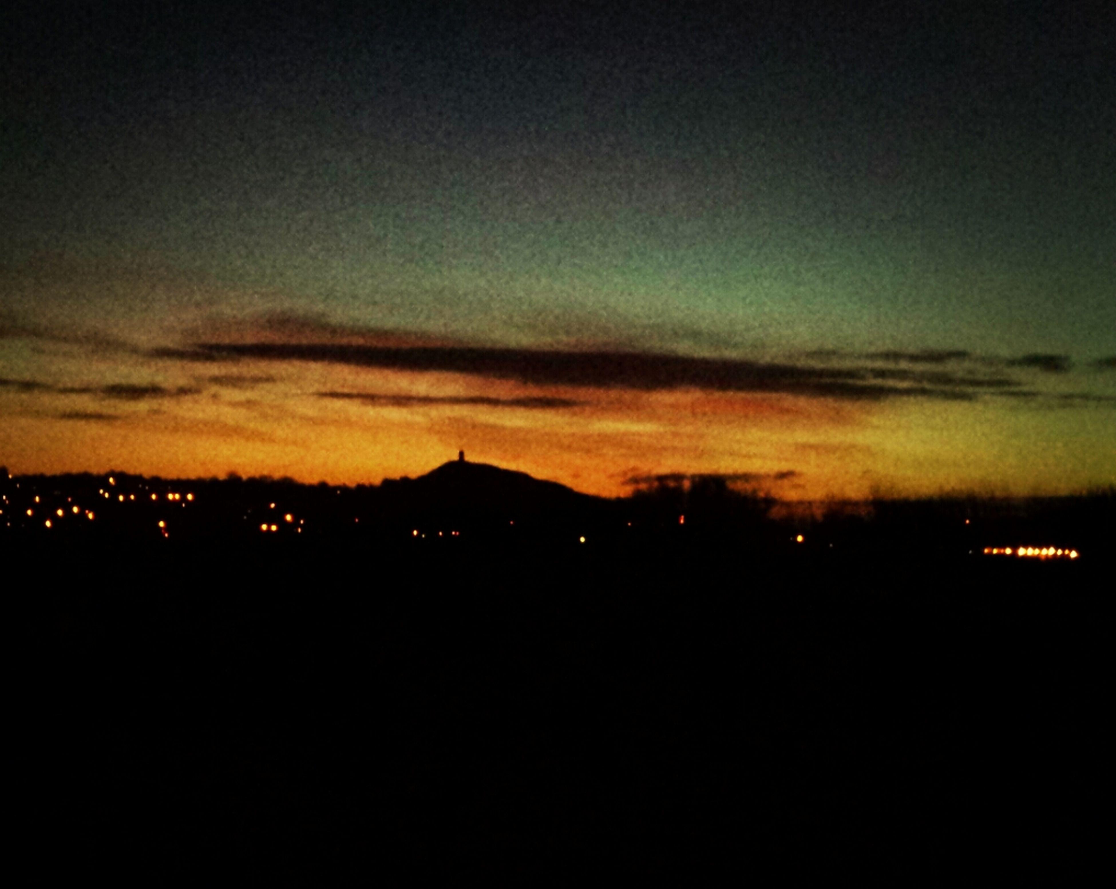 sunset, silhouette, illuminated, sky, building exterior, built structure, scenics, night, dark, dusk, architecture, beauty in nature, landscape, cloud - sky, copy space, city, orange color, tranquil scene, dramatic sky, nature