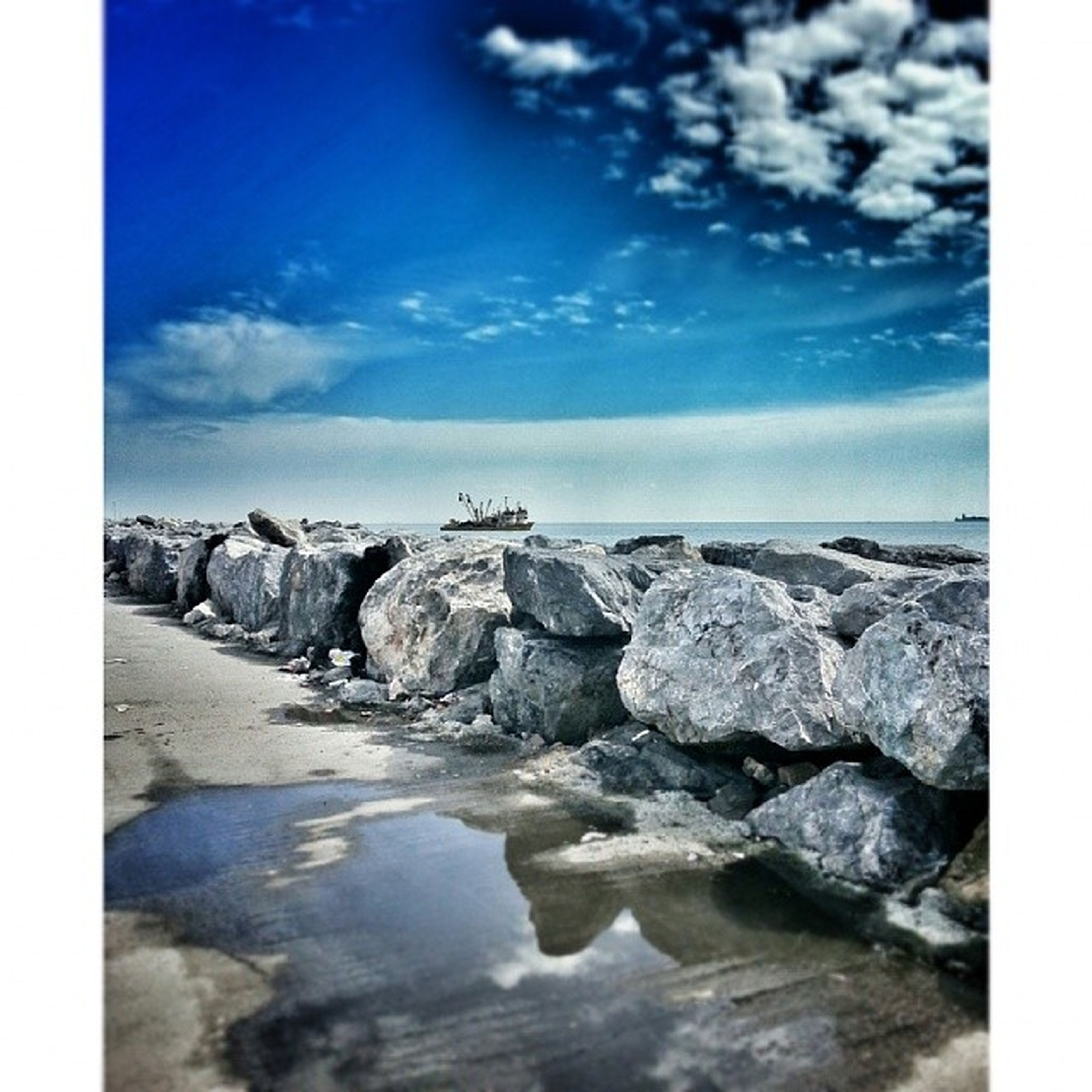 water, sea, transfer print, tranquil scene, sky, tranquility, scenics, rock - object, beauty in nature, beach, auto post production filter, rock, nature, rock formation, horizon over water, shore, cloud - sky, idyllic, cloud, coastline