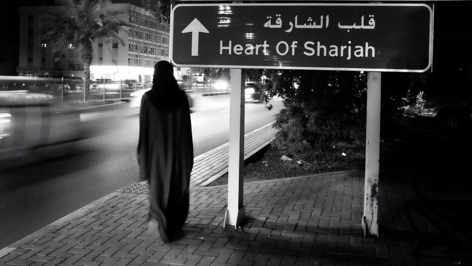 Heart of sharjah (U.A.E) Full Length Transportation Communication One Person Adult Night Architecture Nightphotography Blackandwhite Women Women Of EyeEm Middle East Arabic Arabian Monochrome Sharjah UAE Fujifilm FujiX100T BestofEyeEm Real People Camera - Photographic Equipment Antique Sillhouette Monochrome Photography