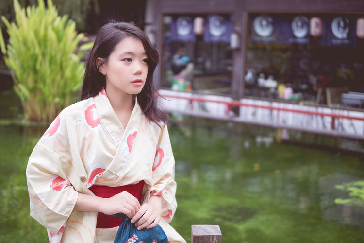 Architecture Beautiful Woman Casual Clothing Day Focus On Foreground Front View Leisure Activity Lifestyles Nature One Person Outdoors Park - Man Made Space Real People Young Adult Young Women
