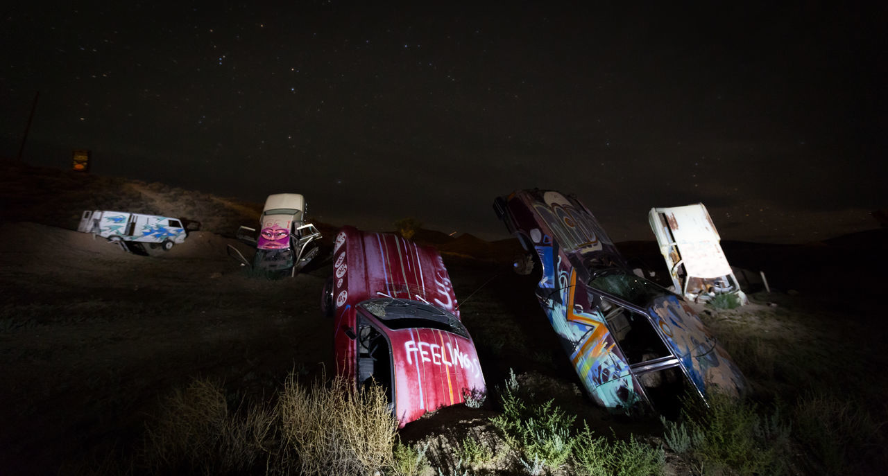 well an intersting art project in nevada ... put the cars into the ground .. i did my lightpoainting and it actually looks quiet cool Cars Graffiti Illuminated Lightpainting Night No People Outdoors Vacations Wreck