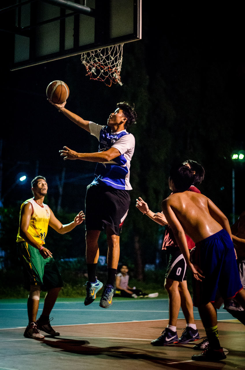 basketball - sport, basketball player, sport, playing, court, competition, real people, basketball hoop, lifestyles, competitive sport, leisure activity, indoors, group of people, men, sportsman, athlete, young adult, full length, sports uniform, sports team, people